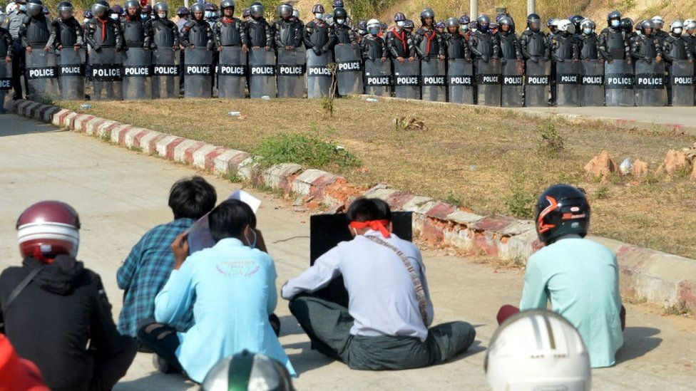 Police line up in front of a prison in the Myanmar capital Nay Pyi Taw during protests against the coup, 15 February 2021