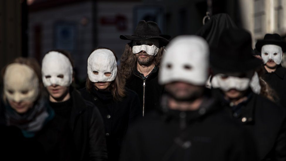 People wearing masks and walk through the streets in the Czech Republic