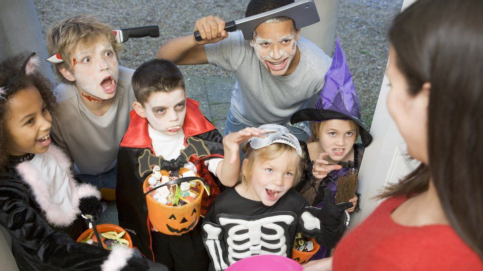 Six children trick or treating on Halloween