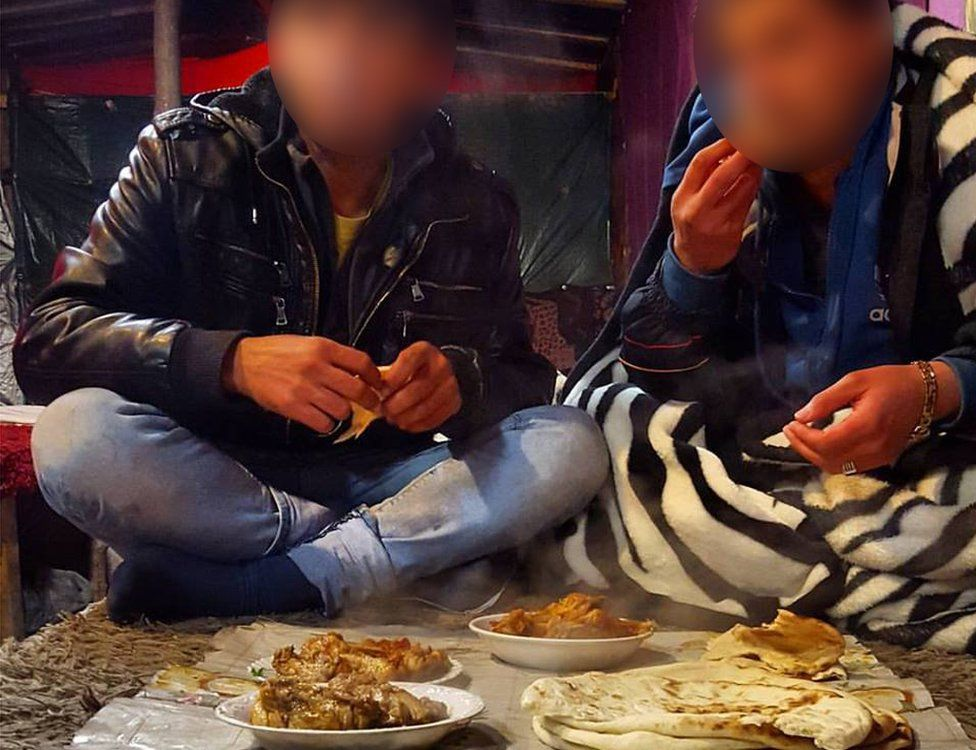 A taste of home: Migrants eating Afghan food in a makeshift cafe