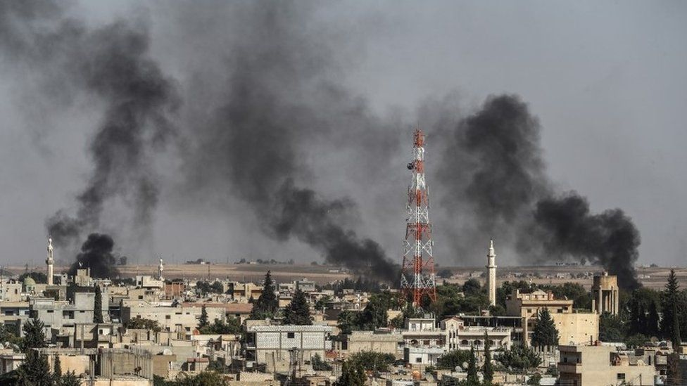 Smoke rises from inside Syria during bombardment by Turkish forces