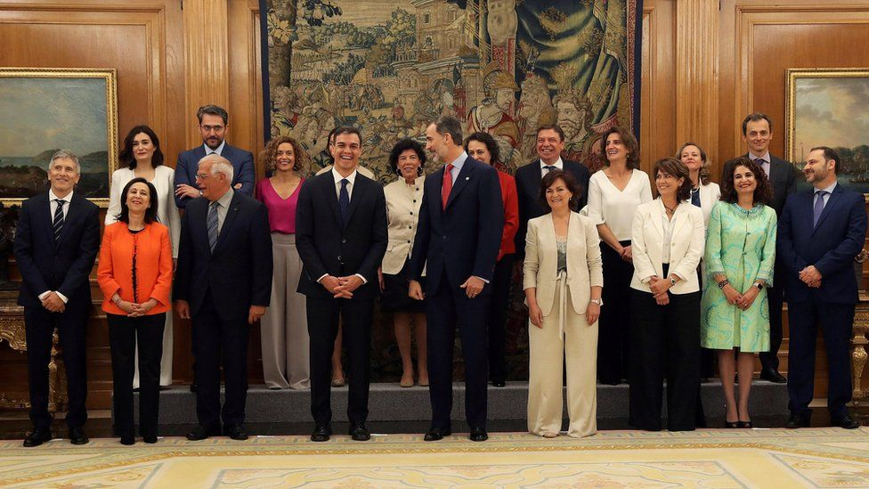 Spain's new cabinet members stand with King Felipe during a swearing-in ceremony at the Zarzuela Palace outside Madrid, Spain, June 7, 2018