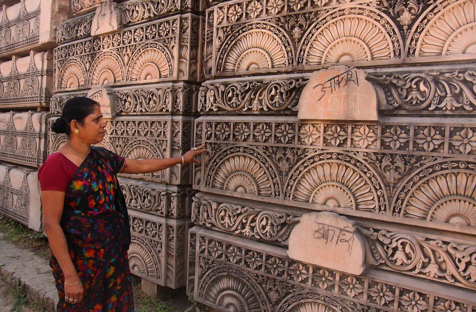 A Hindu woman looks at stone slabs earmarked for the construction of a Hindu temple at a workshop in Ayodhya in 2012.