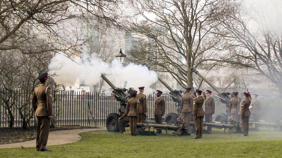 Members of the 4th Regiment Royal Artillery, fire a 21-gun salute in York's Museum Gardens