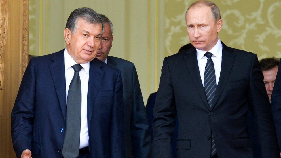 "In this file photo taken on Tuesday, Sept. 6, 2016, Uzbekistan""s Prime Minister Shavkat Mirziyoyev, left, speaks with Russian President Vladimir Putin in Samarkand, Uzbekistan, Tuesday, Sept. 6, 2016"