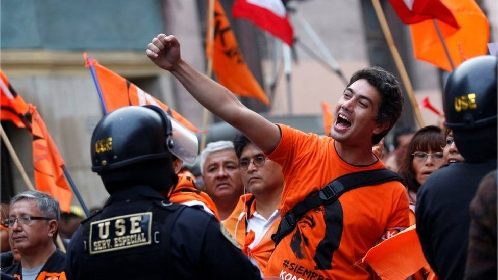 """Supporters of Peruvian presidential candidate Keiko Fujimori shouts slogans outside Peru""""s National Office of Electoral Processes (ONPE) in Lima, Peru, June 7, 2016"""