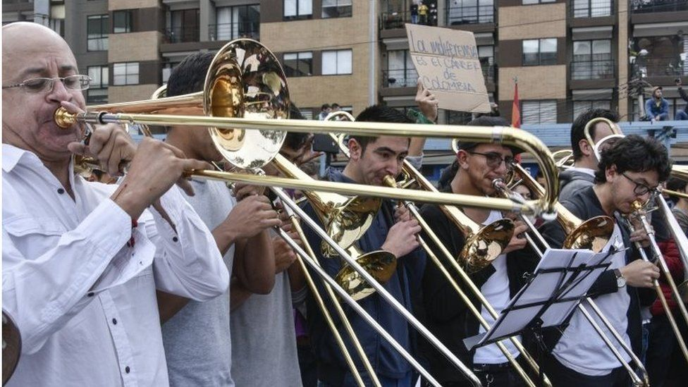 Musicians of the conservatory of the National University of Colombia play their instruments during a protest in Bogota, Colombia