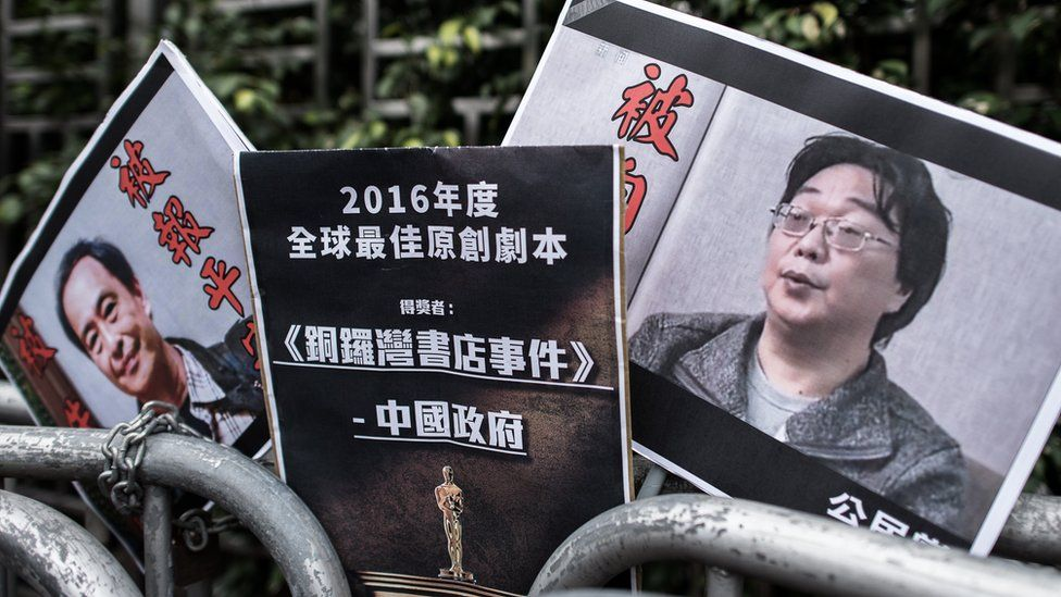 Placards showing missing bookseller Gui Minhai (R) and his associate Lee Bo, pictured in Hong Kong in 2016