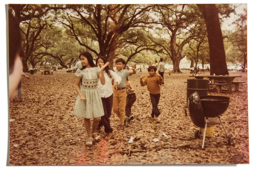 Vira's sister Sundary, her brother Nadirak, and other Khmer children dance at a barbecue in New Orleans