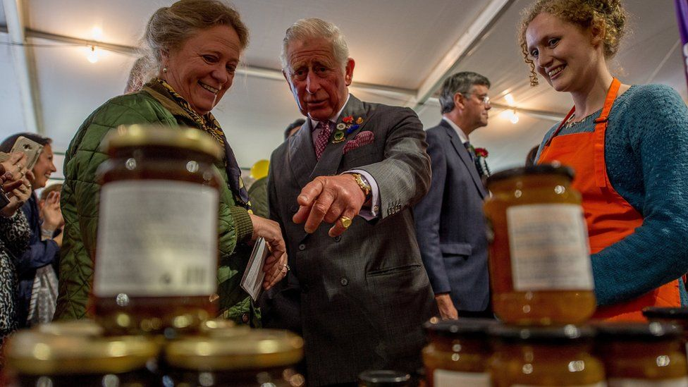 The Prince of Wales meeting stall holders at the Dalemain Marmalade stand