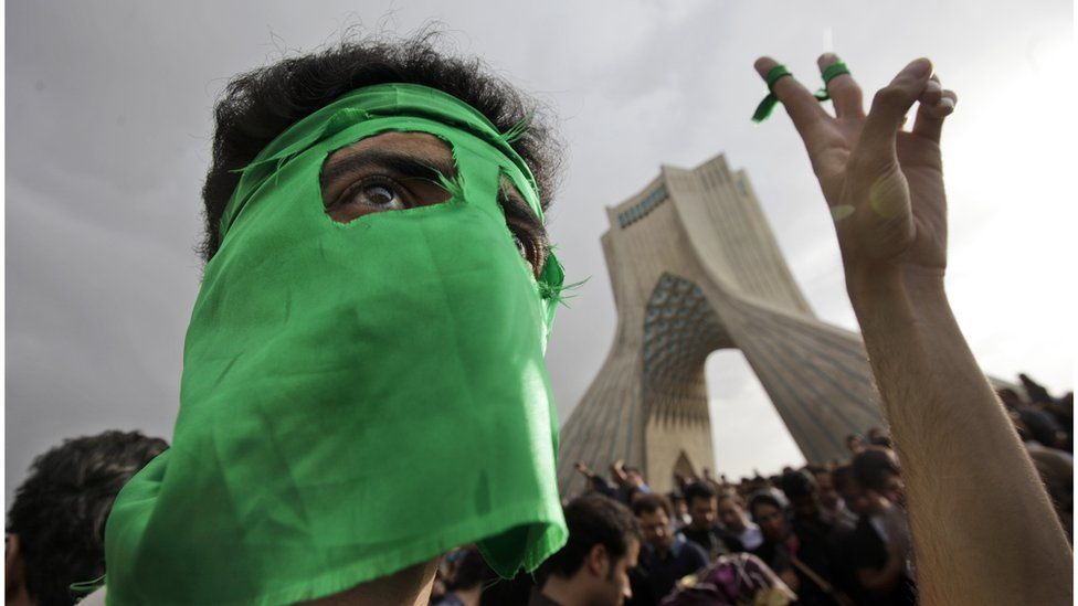 Supporter or defeated presidential candidate Mir Hossein Mousavi in front of Azadi Tower in 2009