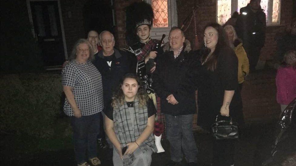 Tony Occleshaw with the piper and his family