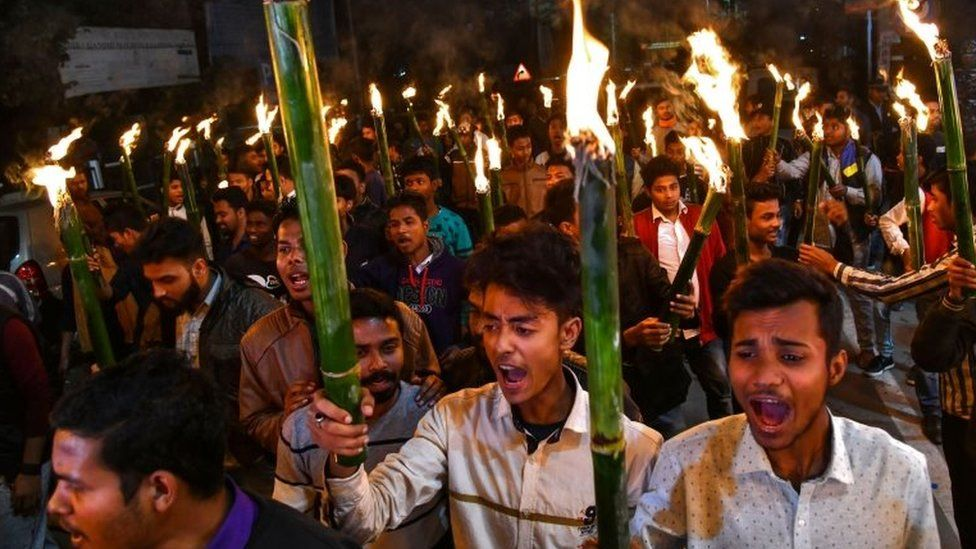 Activists of All Assam Students Union (AASU) along with 30 indigenous organizations take out a torch light procession to protest against the Citizenship Amendment bill in Guwahati on January 31, 2019