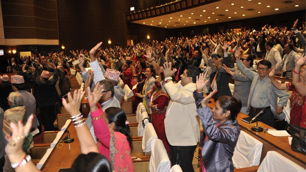 Nepalese MPs cheers as the vote is passed (16 Sept 2015)