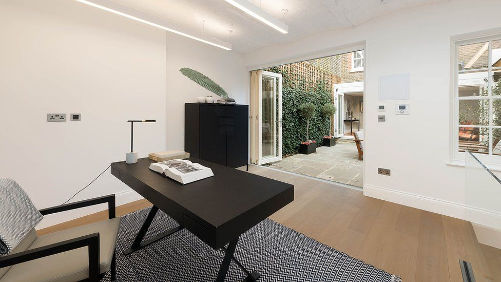 The interior of a modern minimalist courtyard garden office