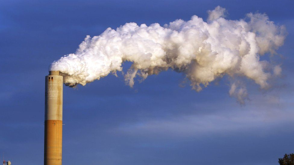 In this Jan. 20, 2015 file photo, steam billows from the chimney or a coal-fired Merrimack Station in Bow, N.H. USA.