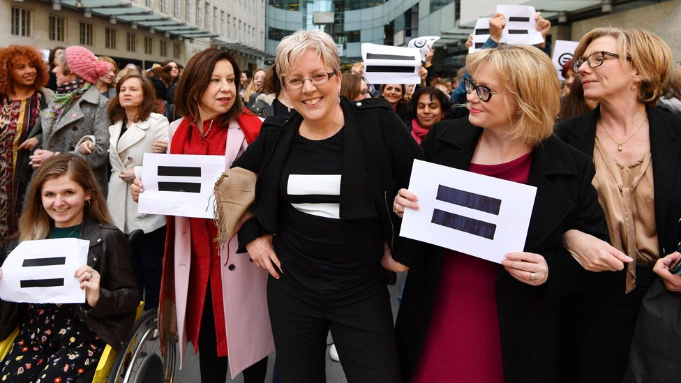 Carrie Gracie (centre) and other BBC employees outside New Broadcasting House in March 2018