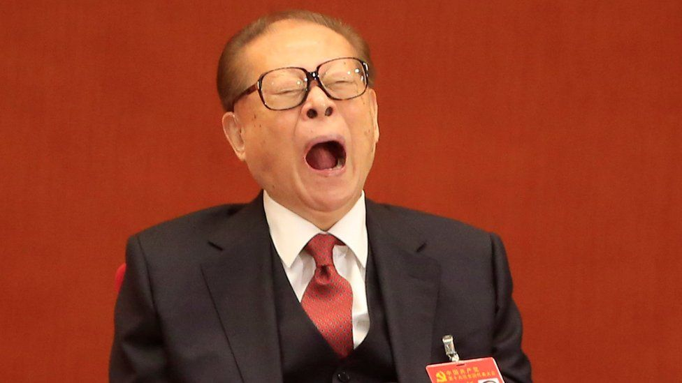Former Chinese President Jiang Zemin is seen yawning during the opening session of the 19th National Congress of the CPC