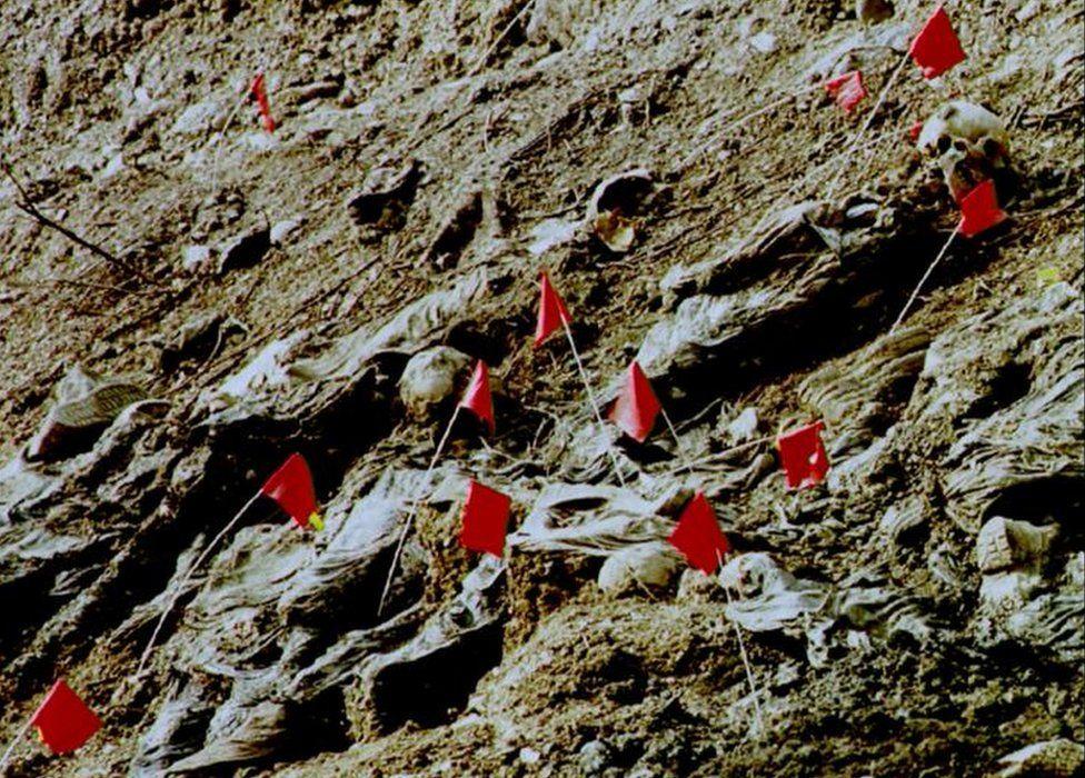 File photo shows mass grave discovered in Srebrenica