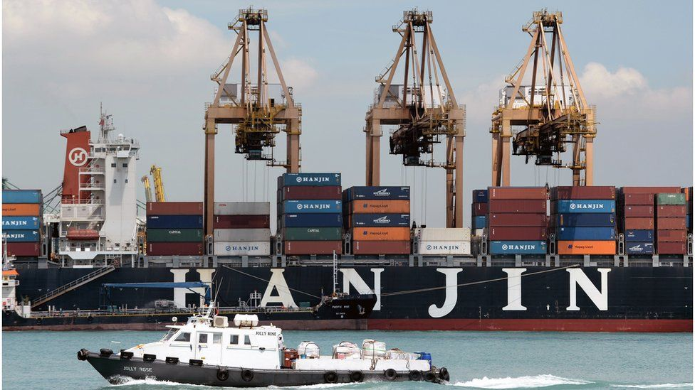 A container ship sits docked at the Keppel terminal container port in Singapore (April 12, 2013)
