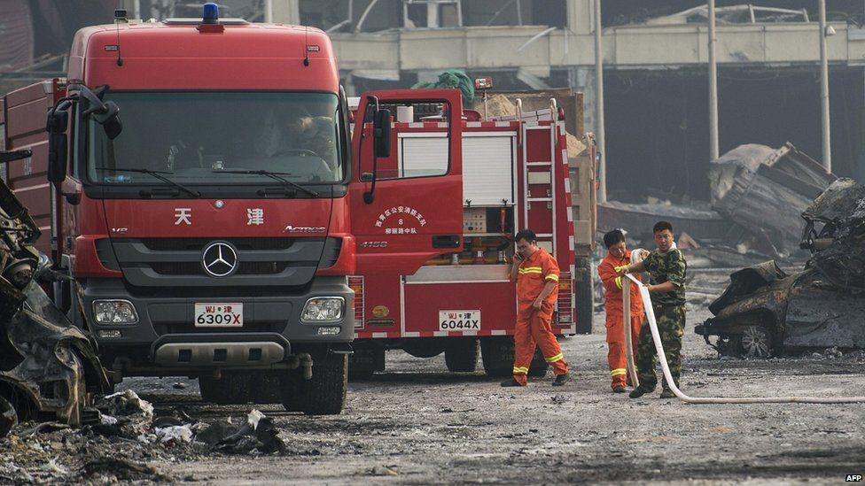 Firemen at the scene of the explosions in Tianjin