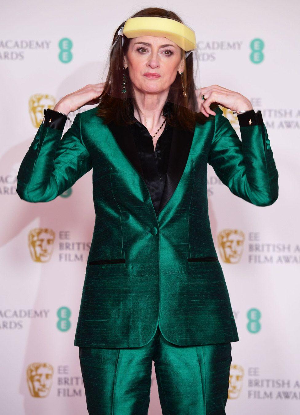 Bafta chief executive Amanda Berry sported a visor on the red carpet