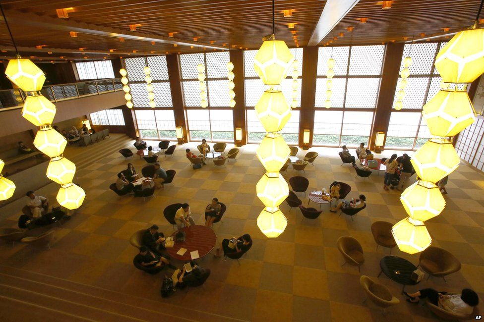 In this photo Thursday, Aug. 20, 2015, visitors relax at the lobby at main lobby of Hotel Okura in Tokyo.