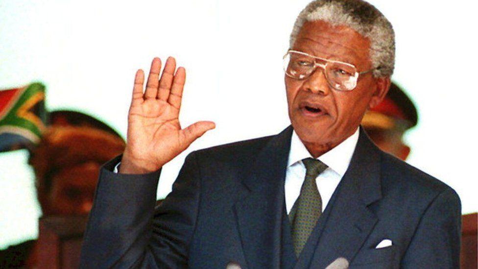 Nelson Mandela taking the presidential oath in 1994