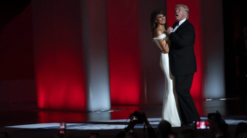 US President Donald J. Trump (R) and his wife First Lady Melania Trump (L) dance at the Liberty Ball