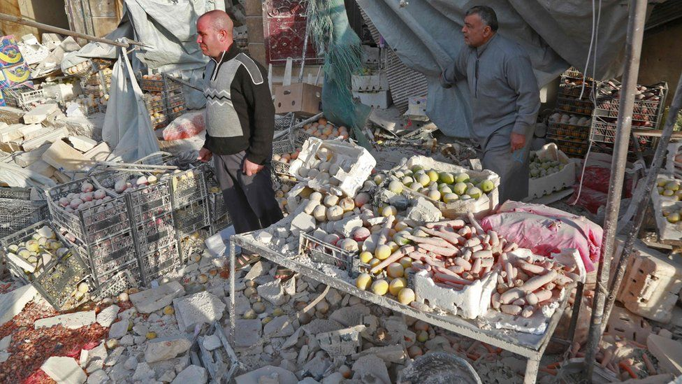 Aftermath of a reported air strike on a market in the rebel-held town of Atareb in northern Syria on 13 November 2017