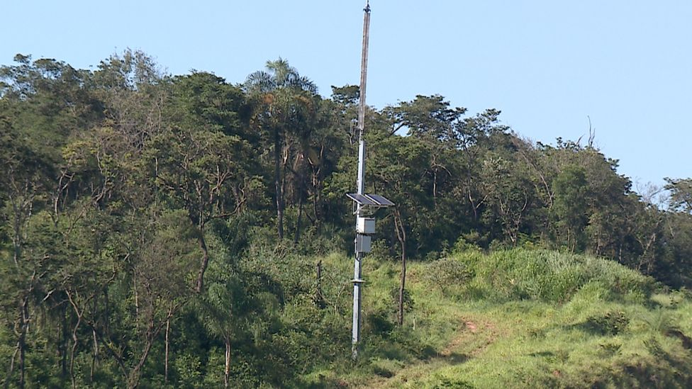 A mast with a warning siren attached