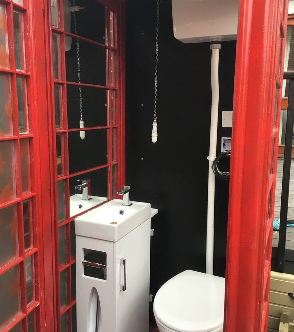 A phone box converted to a lavatory
