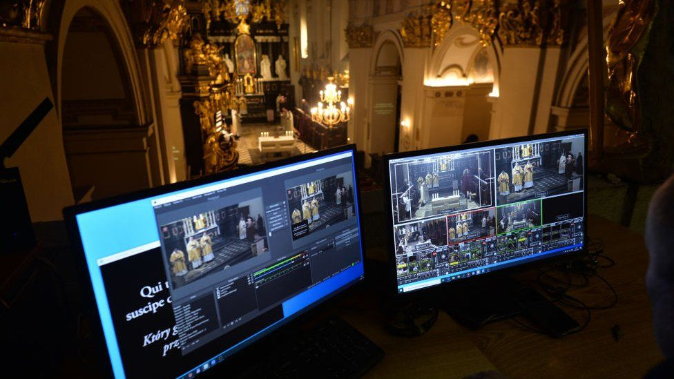 Screens in a church in Tyniec, Poland, during a Maundy Thursday service