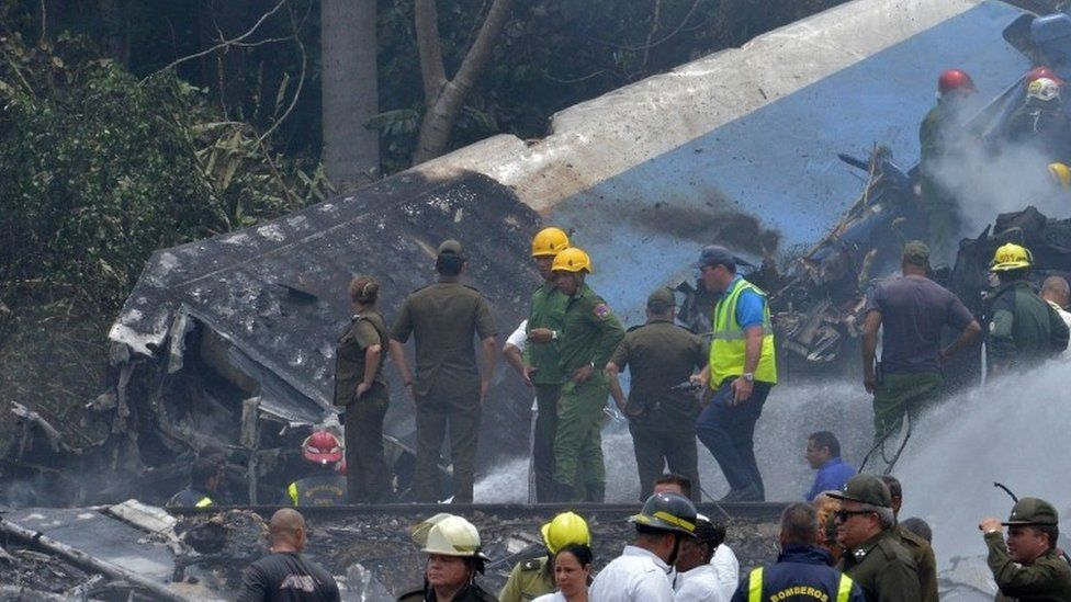 Emergency personnel work at the site of the accident on 18 May 2018.