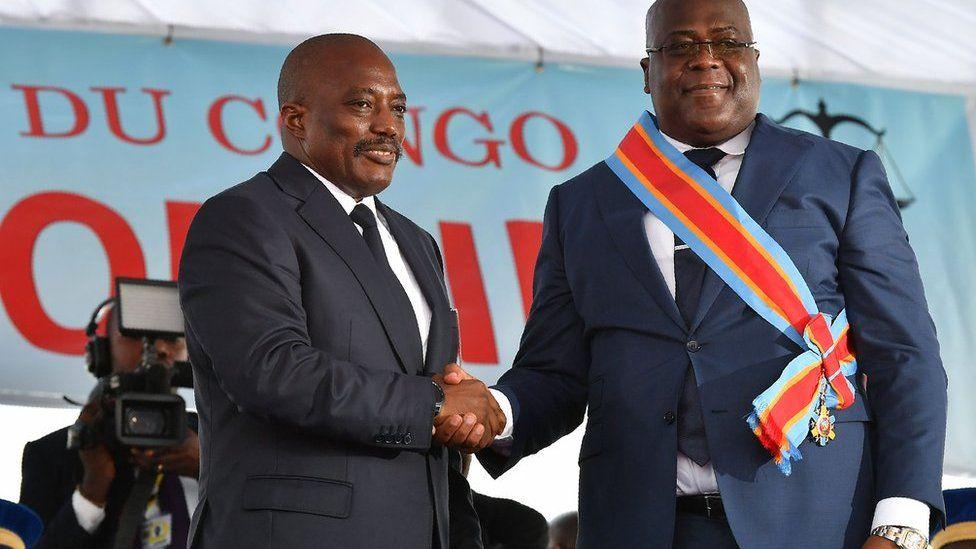 Joseph Kabila shakes Felix Tshisekedi's hand