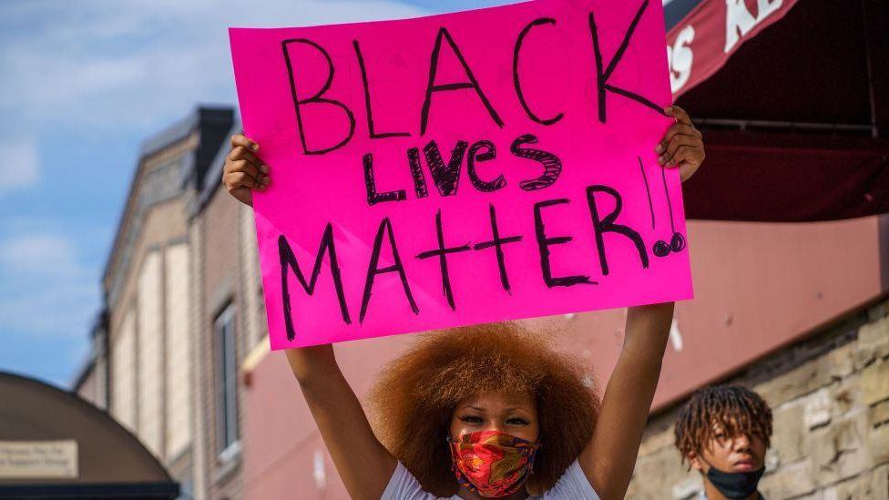 Woman holding a black lives matter sign