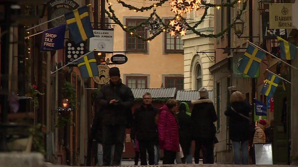 People walk on a street in Stockholm