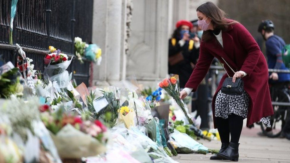 Floral tributes are left outside Buckingham Palace