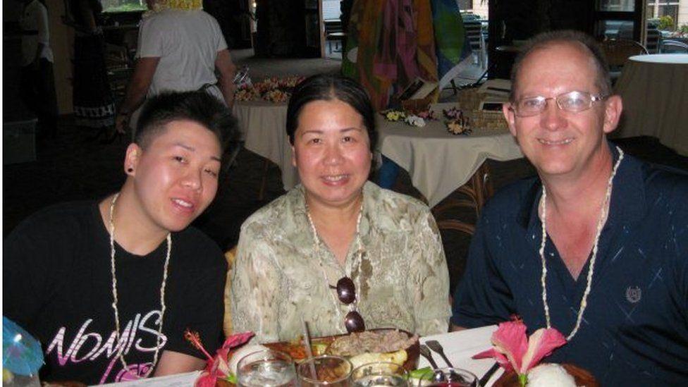 Ms Phan-Gillis alongside family members in a restaurant