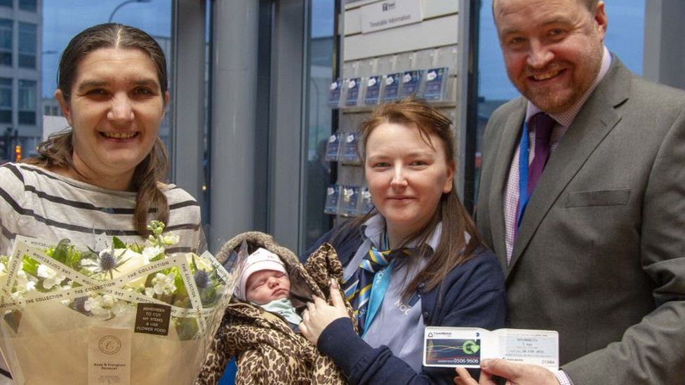 Katie Couldwell, Rebecca Hall who delivered the baby, Destinie, and Tim Taylor of South Yorkshire Passenger Transport Executive
