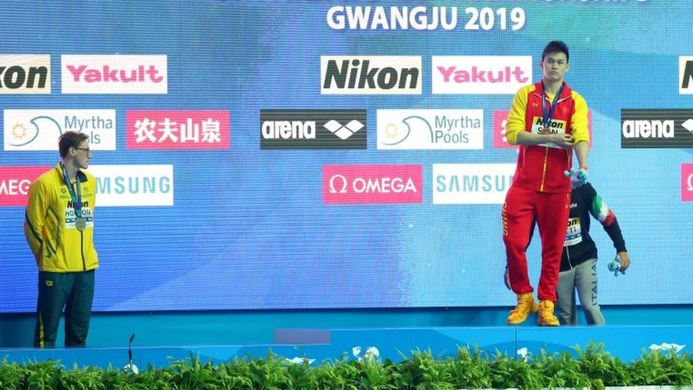 Mack Horton refuses to join rival Sun Yang on a medal podium