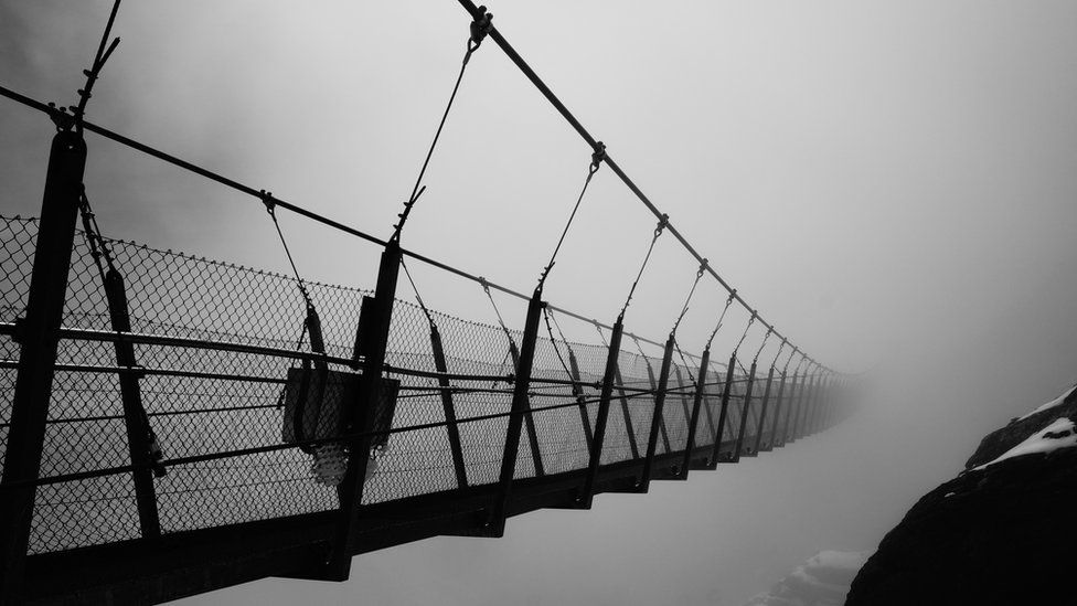Titlis Cliff Walk in Switzerland floating in the midday cloud