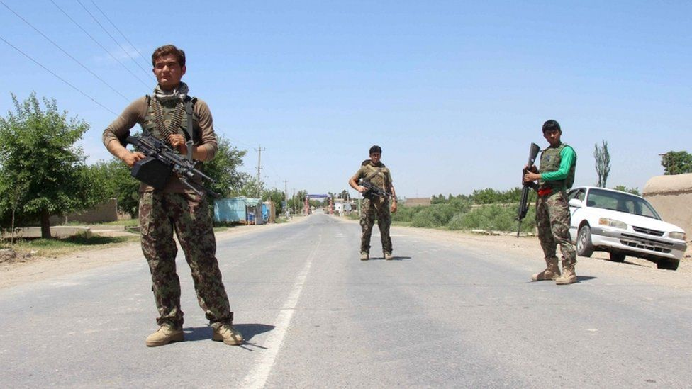 Afghan National Army troops keep guard during a gunfight in Kunduz province