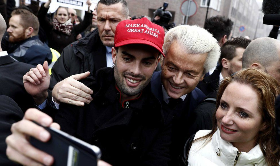 Dutch politician and leader of the Party for Freedom (PVV) Geert Wilders joins with members of the public to be photographed together in the center of Spijkenisse, The Netherlands, 18 February 2017