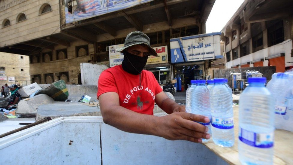 A man sells cold water in Baghdad