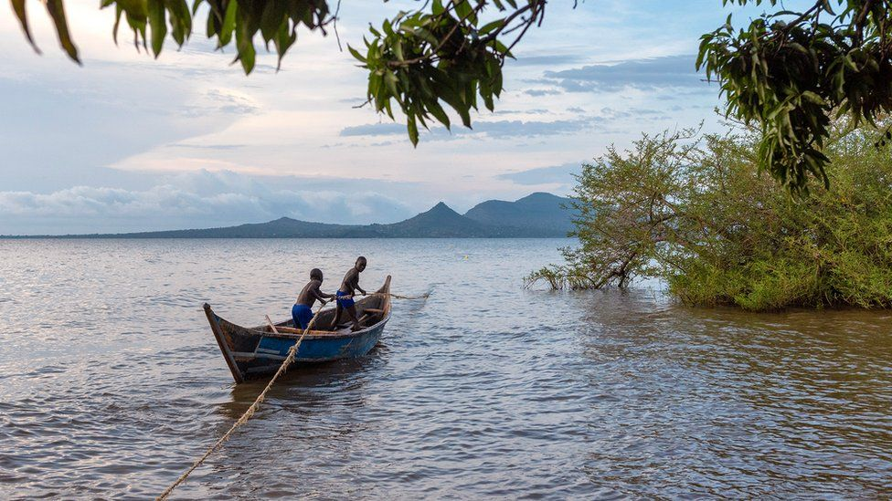 Kenyan boys on a fishing boat on Lake Victoria