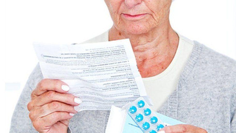 Woman reading patient information leaflet