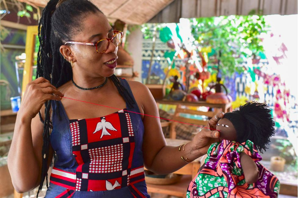 The Burkinabe artist and doll designer Mare Abibou sews up one of her creations as she stands in her workshop in Ouagadougou on October 27, 2018.