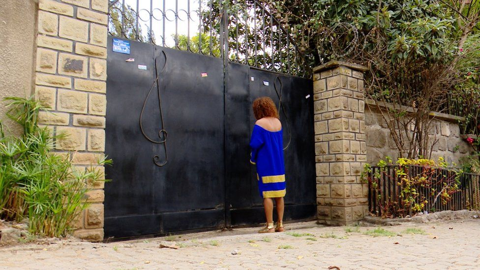 Hamelmal Abate at the gate to the house she is giving to become a quarantine centre in Addis Ababa