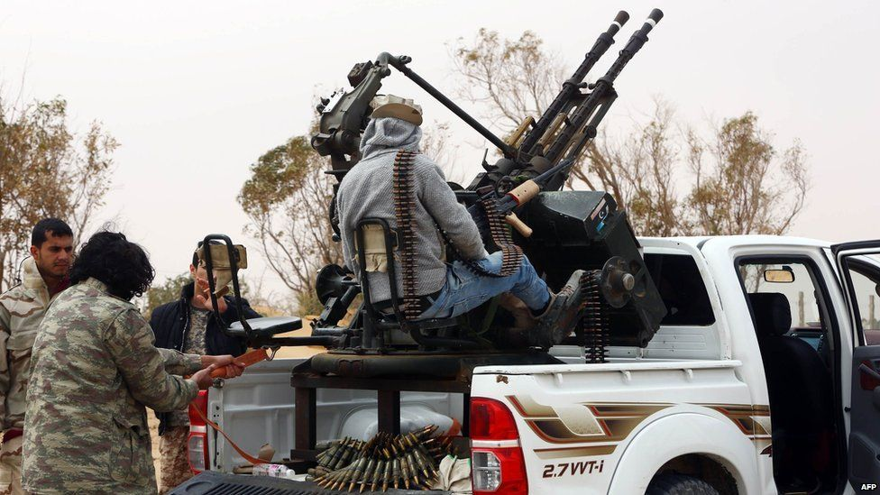Members of forces loyal to Libya's Islamist-backed parliament General National Congress (GNC) prepare to launch attacks as they continue to fight Islamic State (IS) group jihadists on the outskirts of Libya's western city of Sirte